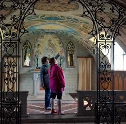 Anna shows Nicola the Italian Chapel